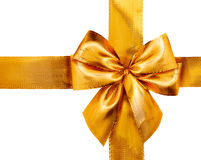 Gold satin gift bow. Ribbon isolated on white Royalty Free Stock Photography