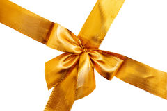 Gold satin gift bow. Ribbon isolated on white stock photo