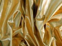 Gold satin material Stock Image