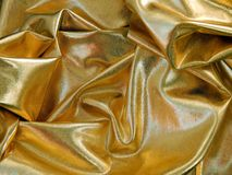 Gold satin material Stock Images