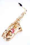 Gold Saxophone Pink Rose. A gold saxophone with a pink rose isolated on a high key white background in the vertical view Royalty Free Stock Photo
