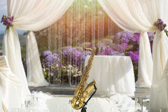 Gold saxophone in wedding ceremony decoration Stock Images