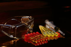 Gold Science Medical R & D, dropper, goggle, syringe, stethoscop Royalty Free Stock Photos