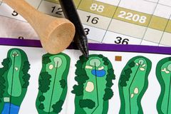Gold Scorecard. A golfer's score card and golf tees from the course Royalty Free Stock Photography