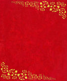 Gold scroll corners on red textured background Royalty Free Stock Photography