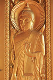Gold sculpture of buddha with ok hand sign Stock Photos