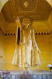 Gold sculpture of Buddha pointing Royalty Free Stock Photo