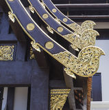 Gold sculpture decoration on temple roof Stock Image