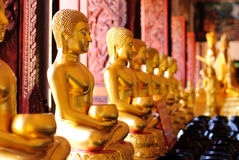 Gold sculpture image of Buddha Stock Photo