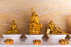 Gold Sculptures of Venerated Monks at Canton Shrine. BANGKOK, THAILAND - 8 FEB 2016: Gold Sculptures of Venerated Monks at Canton Shrine Stock Photo