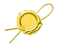 Gold seal or tag with thread Royalty Free Stock Photo