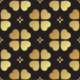 Gold seamless pattern with clover leaves, the symbol of St. Patrick Day in Ireland Stock Photography