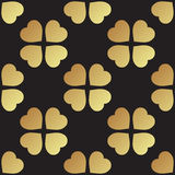 Gold seamless pattern with clover leaves, the symbol of St. Patrick Day in Ireland Stock Images