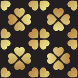 Gold seamless pattern with clover leaves, the symbol of St. Patrick Day in Ireland Stock Image