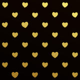 Gold seamless pattern of hearts on black background Stock Photos