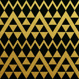 Gold seamless pattern of triangles on black background Royalty Free Stock Image