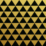 Gold seamless pattern of triangles on black background Stock Photo