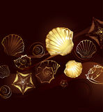 Gold seashells. Brown background with gold jewelry with seashells and starfish Royalty Free Stock Images