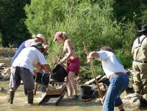 Gold seekers. Using a sluice box in a river in France Stock Photo