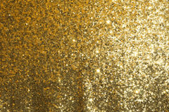 Gold sequined fabric. Texture background stock images