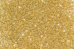 Gold sequins. Bright shine. Yellow powder. Glitter. Shining back Royalty Free Stock Photos