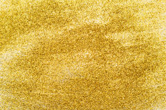 Gold sequins glittering in the background. Royalty Free Stock Image