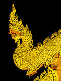 Gold serpent art in temple Stock Image