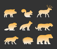Gold set of figures of wild animals Stock Photography