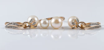 Gold set of ring and earrings with pearl Royalty Free Stock Photos