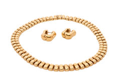 Gold sets. Sets consisting of gold necklace and earrings on a white background Stock Images