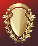 Gold shield. Ribbon, oak and laurel branches Stock Photo