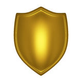 Gold shield front lit. Isolated on white Royalty Free Stock Photos