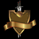 Gold shield with gold ribbon and swords. Royalty Free Stock Photography