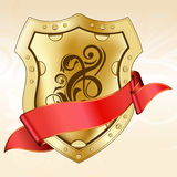 Gold shield with ribbon Royalty Free Stock Photography