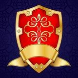Gold shield with ribbon Royalty Free Stock Photo