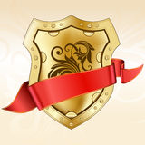 Gold shield with ribbon Royalty Free Stock Images
