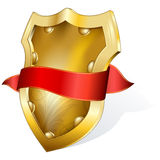 Gold shield with ribbon Royalty Free Stock Photos