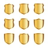 Gold shield shape icons set. 3D golden emblem signs isolated on white background. Symbol of security, power, protection. Badge shape shield graphic design Royalty Free Stock Images