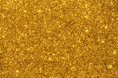 Golden glitter for texture or background Stock Images