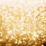 Gold shine lights frozen snow bokeh. Winter background royalty free stock photography