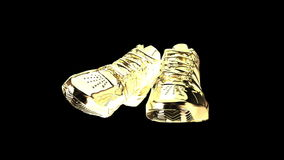 Gold shiny athletic sneakers Stock Photo