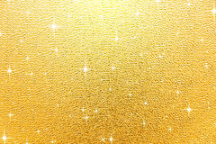 Gold shiny background. Golden sparkling christmas background with stars vector illustration