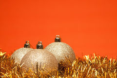 Gold shiny christmas balls with tinsel Royalty Free Stock Images