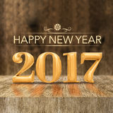 Gold shiny Happy New year 2017 3d rendering at wooden block ta Royalty Free Stock Photography