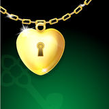 Gold shiny heart lock on chain with key Stock Image