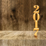 Gold shiny 2017 new year 3d rendering at wooden block table an. D blur wood wall,Holiday greeting card,Mock up for display of your design or content Royalty Free Stock Photography