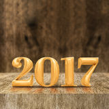 Gold shiny 2017 new year 3d rendering at wooden block table an. D blur wood wall,Holiday greeting card,Mock up for display of your design or content stock illustration
