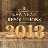 Gold shiny 2018 new year resolutions 3d rendering at wooden bl. Ock table and blur wood wall,Holiday greeting card,Mock up for display of your design or content Royalty Free Stock Image