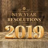 Gold shiny 2019 new year resolutions 3d rendering at wooden bl. Ock table and blur wood wall,Holiday greeting card,Mock up for display of your design or content royalty free illustration