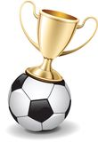 Gold shiny trophy cup on  top of soccer ball. Gold shiny trophy cup on the top of soccer ball. Good for icons Royalty Free Stock Photography